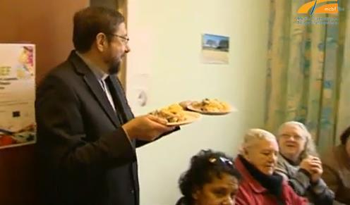 Mgr Delville dans la Communauté Sant'Egidio... Au service des plus démunis.