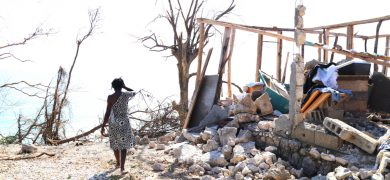 Mikai Edward 42, lost her home where she lives with her six children and husband in front of the ocean in the Zoranje neighborhood of Roche Bateau.